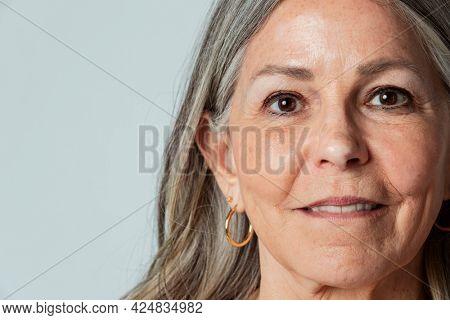 Happy senior woman in a studio shoot