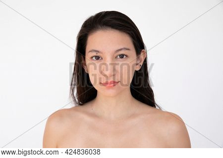 Bare chested woman in a studio shoot