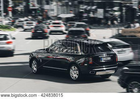 Kiev, Ukraine - May 22, 2021: Black Luxury British Rolls Royce Cullinan Suv In Motion. Rolls Royce C