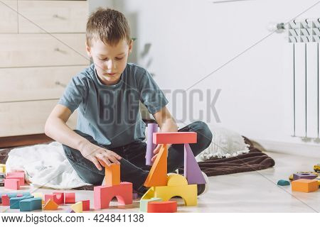 7-10 Boy, Playing At Home On The Floor With Geometric Shapes Constructor