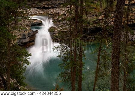 Forest Waterfall Johnston Canyon. A Waterfall In The Woods. Johnston Canyon In Banff National Park,