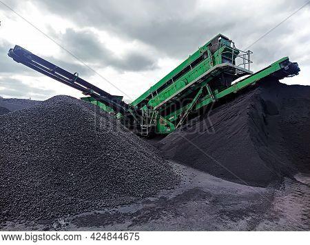 A Loader Harvester For Loading Bulk Cargo Drives Onto A Pile Of Granite At The Port Quay. Mechanized