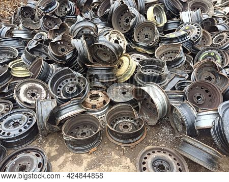 Old Car Alloy Wheels On The Quay Of The Port Prepared For Transportation For Processing. Recycling O