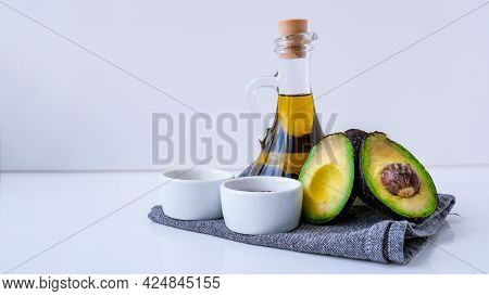 Olive Oil In Glass Bottle With Sesame And Flax Seeds. Fresh Ripe Hass Avocado. Healthy Eating. Veget