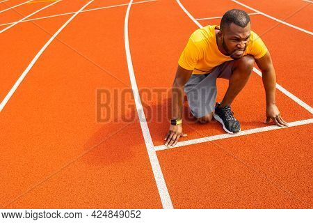 Pensive Sporty Man Getting Focused And Ready For Running Training. Afro American Runner Athlete Stan