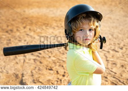 Child Batter About To Hit A Pitch During A Baseball Game. Kid Baseball Ready To Bat.