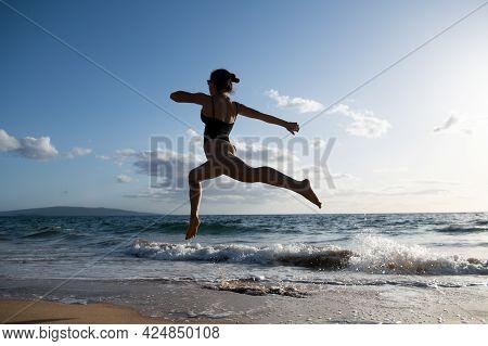 Woman Running On Beach. Beauty Sexy Woman Run On Sea Beach.