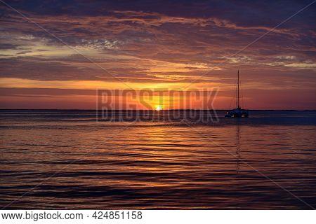 Seascape. Boat On Sea. Sailboats At Sunset. Ocean Yacht Sailing Along Water.