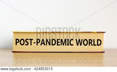 Covid-19 Post-pandemic World Symbol. Concept Words 'post-pandemic World' On Book On Wooden Table. Be