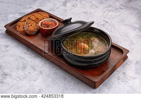 Soup With Shrimps, Sauce, Bread, Croutons, On A Wooden Board, On White Background