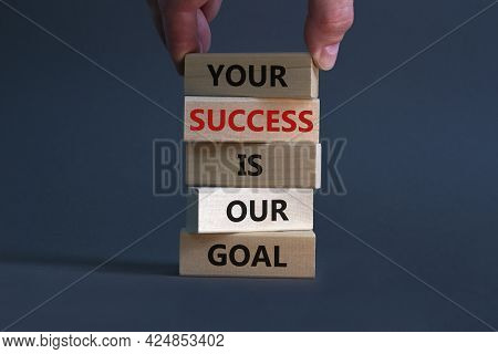 Your Success Is Our Goal Symbol. Wooden Blocks With Words 'your Success Is Our Goal'. Businessman Ha
