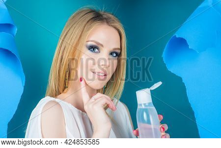 Woman With Bottle Of Micellar Water. Beauty Treatment. Makeup Remover. Skin Care. Face Tonic.