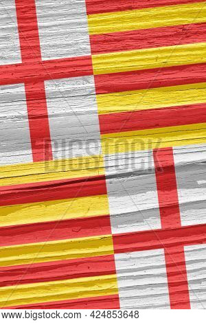 Fragment Of The Flag Of The City Of Barcelona On Dry Wooden Surface, Cracked With Age. It Seems To F