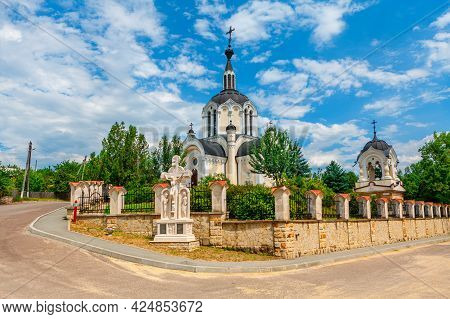 Church Steeple And Crucifixion . Orthodox Church In Village Donici From Moldova