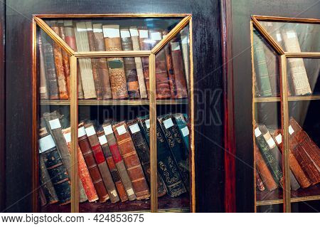 Library With Old Books . Antique Books In The Cupboard