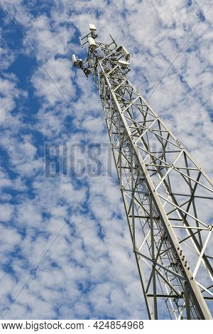 Antenna  Tower Of  Communication On Blue Sky And Clouds, Mobile Phone Antenna Tower.