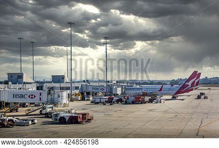 Sydney, Australia - May 18, 2019: Qantas Airlines Planes Docked At Jetways Of Kingsford-smith Intern