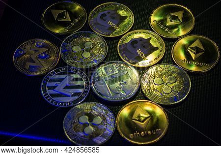 Altcoins Over Dark Surface In Neon Light