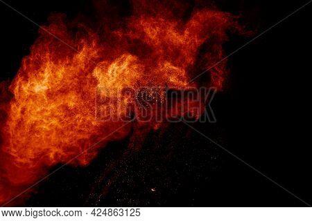 Orange Powder Splattered On Black Background.abstract Dust Cloud  Backdrop.