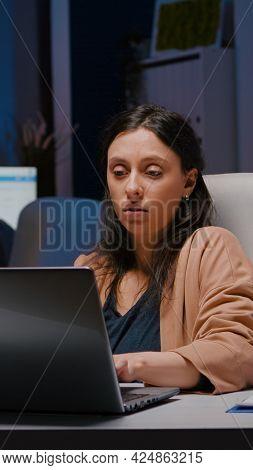 Workaholic Entrepreneur Woman Sitting At Desk Table Analysing Financial Graphics Using Laptop Comput