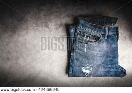 Jeans Pant Lay On Cement Floor. Fashion, Clothes For Any Gender, Classic Wearing For Diversity. Top