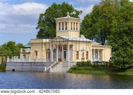 Peterhof, Russia - May 29, 2021: The Old Tsaritsyn Pavilion On Olgin Pond On A Sunny May Day