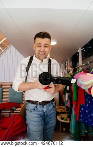 Photographer With A Camera On Leather Belts Takes A Selfie In The Dressing Room