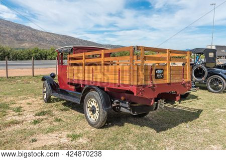 Villiersdorp, South Africa - April 12, 2021: Back View Of A Red Vintage 1927 Chevrolet Pickup Truck