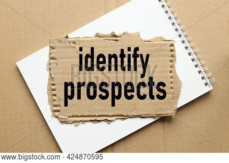 Identify Prospects . Text On Torn Cardboard. Black Letters. On Craft Background