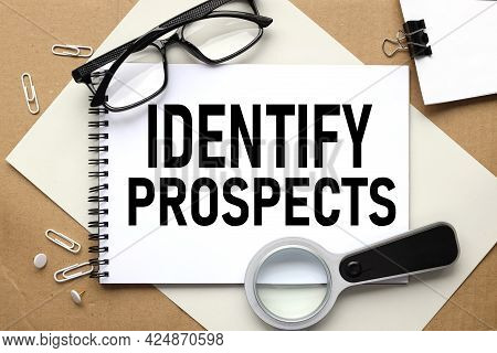 Identify Prospects. Text On White Notepad On Craft Background
