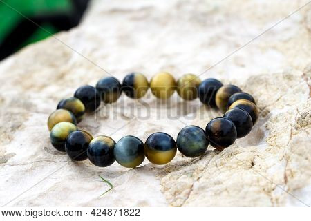 Tiger's Eye (also Called Tiger Eye) Is A Chatoyant Gemstone That Is Usually A Metamorphic Rock With
