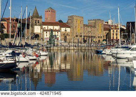 Gijon, Spain - September 28, 2019: Gijon Marina At Sunset With Historical Buildings Reflected On The