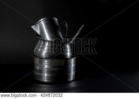 Old Stainless Steel Water Jug In Steel Pot, Stainless Steel Serving Sets In Black Background, Old St
