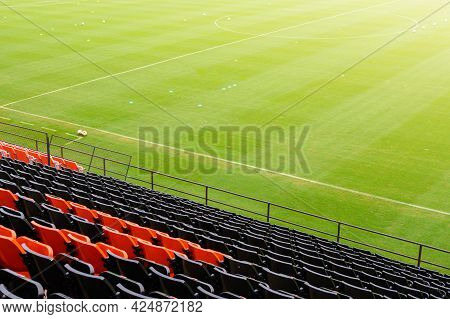 An Empty Rows Of Plastic Seats In Football Stadium. Stadium Seating Is A Seating Arrangement In Stad