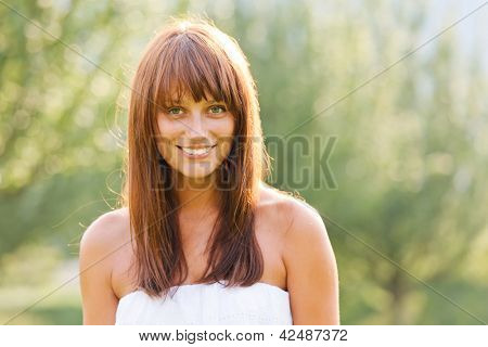 Summer Portrait Of Young Smiling Woman