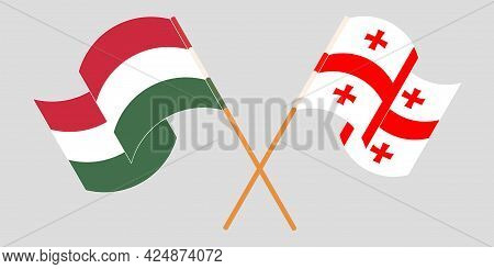 Crossed And Waving Flags Of Georgia And Hungary