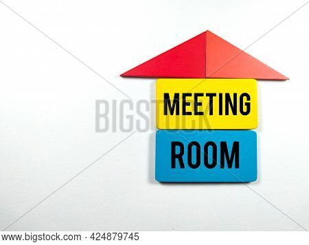 Colorful Wooden Board With Text Meeting Room On White Background.