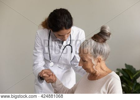 Caring Female Nurse Help Old Woman Patient