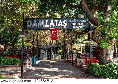 Alanya, Turkey - October 23, 2020: Signboard With The Turkish Flag At The Entrance To Damlatas Cave