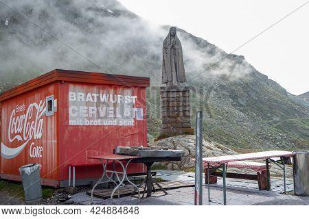 Gotthard Pass, Switzerland - June 15th 2020: Kiosk Next To The Madonna Statue