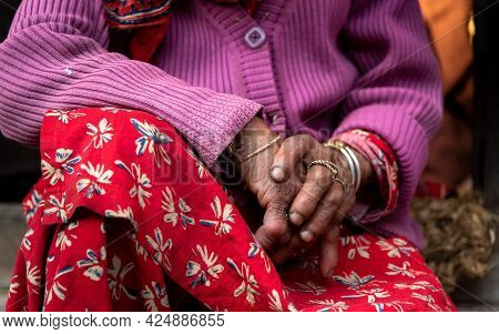Close Up Details Of The Crossed Wrinkle Hands Of An Elder Grandmother Nepalese Woman.