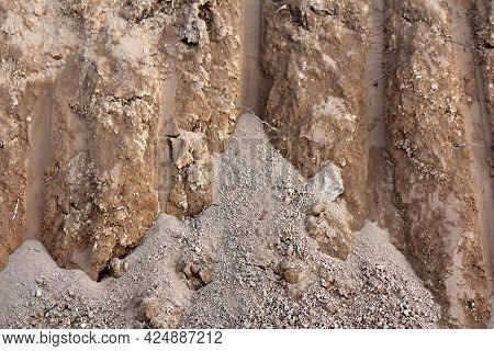 Dry Dirt Mixed With Small Grain Sand In Freshly Dig Ditch At Local Construction Site Texture Backgro