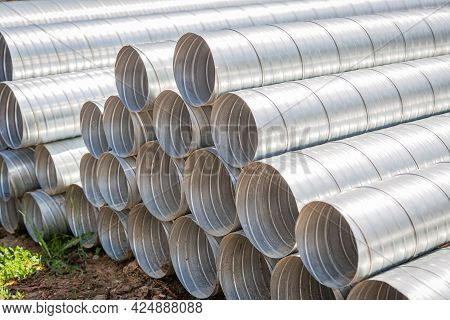Ventilation Pipe Warehouse. Steel Pipes, Parts For The Construction Of Air Ducts For An Industrial A