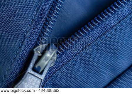 The Macro Shot Of A Color Zipper On A Color Textile Accessories, Locking And Unlock