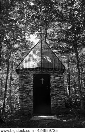 Old Stone Christian Church Stands Alone In Middle Of Forest. Black And White Vintage Photo. Orthodox