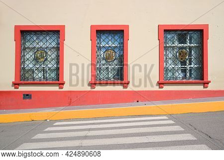 Impressive Facade Of The Building In The City Of Puno, Historic Place In Peru, South America