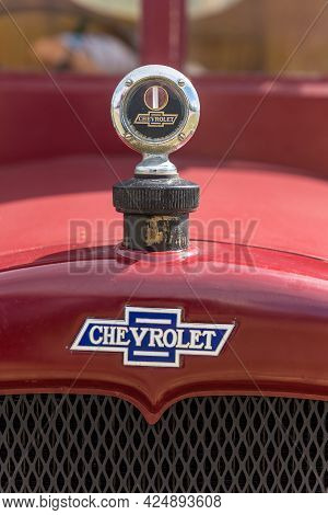 Villiersdorp, South Africa - April 12, 2021: Logo And Radiator Cap Of A Red Vintage 1927 Chevrolet P
