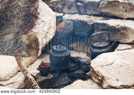 Dishes Are Heated On A Fire, Water Is Boiled In A Kettle, A Camp Kitchen