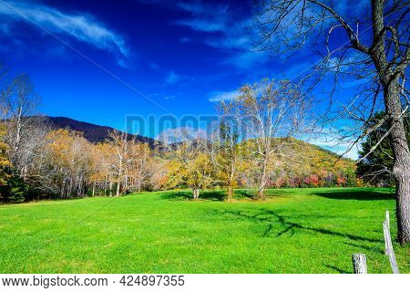 This Image Shows The Amazing Blue Skies And Vibrant Green Pastures Seen At Cades Cove In The Autumn.