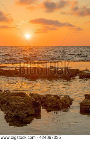 Sunset View Of The Mediterranean Sea Coast, With Abrasion Platforms, In Shikmona Park, Haifa, Israel